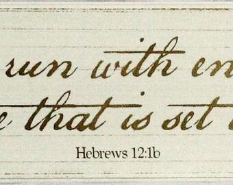 Hand made antiqued sign of Hebrews 12:1b.