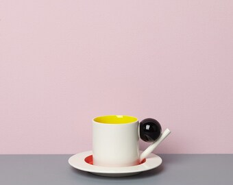 Geometric cup & saucer / black, yellow, red