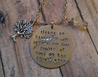 Sister to sister we'll always be, a couple of nuts off the family tree stamped necklace