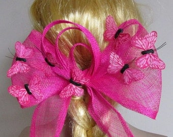 Extra large pink  sinamay bow butterfly fascinator hat.  Held with a clip. Left handed.