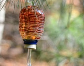 hummingbird feeder, transparent red feathered pattern