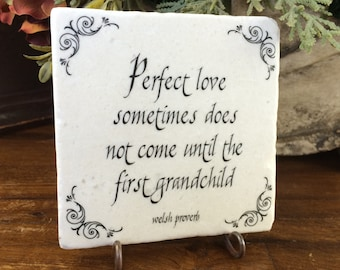 Grandparent gift.  Perfect love sometimes does not come until the first grandchild. Tumbled marble keepsake quote on plaque.