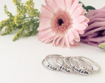 Stacked name rings, sterling silver, spacer rings