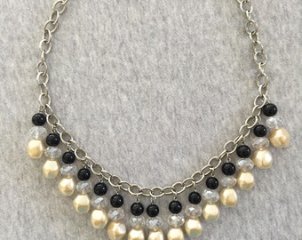 Clear, black and beige necklace