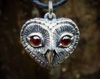 Owl necklace , silver and garnet heart shaped pendant.