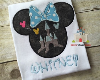 Minnie Mouse silhouette with Castle and a Light blue with White polka dot Bow on a White T-shirt. Inspired by Minnie Mouse and Disney.