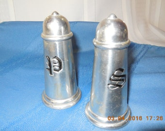 """A set of salt and pepper shakers with """"S"""" and """"P"""" on them.  They do have rubber stoppers in the holes in the bottom."""
