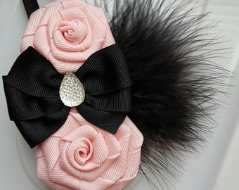 Pink Roses With A Black Bow And Feathers on a Stretchy Headband