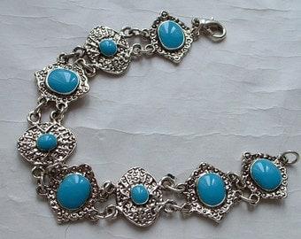 Silver tone metal and enamel bracelet