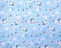 Blue fabric with Cute bunny Face and love hearts printed!