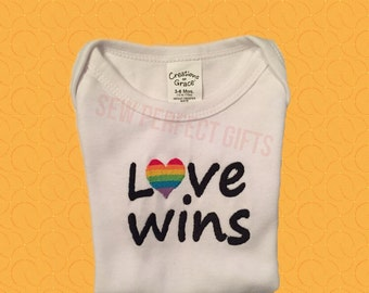 LGBT baby onesie love wins support marriage equality rainbow heart