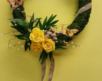 Moss wreath with yellow roses