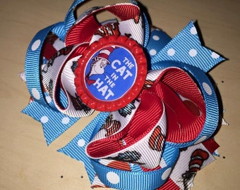 The cat in the hat bow