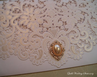 Elegance. Luxury Lace Effect Wedding Invitation with Pearl and Diamanté Brooch.