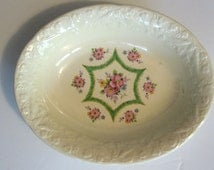 Crooksville China oval serving bowl 1940s vintage china. Embossed edge with birds and fruit, green Hex star, florals on ivory.