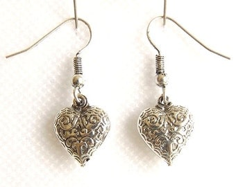 Silver plated earrings, Heart shaped design with filigree style patterning. Nickel free. Hand made in Brazil.
