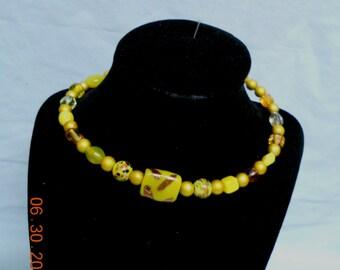 Yellow wrap around glass bracelet and earring set