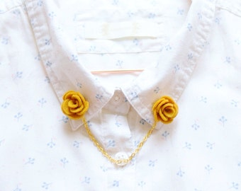 A set of mustard yellow flower collar clips, loved and worn with preppy collared shirts or as cardigan clips (sweater pins in US)