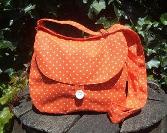 Orange polka dotted canvas shoulder bag,buttoned bag