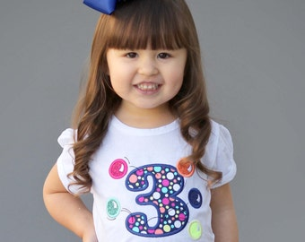 Girl's Birthday Shirt with Bouncing Balls, Number and Embroidered Name - White Puff Shirt