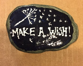 """Vermont River Stone painted with """"Make a Wish"""" and Dandelions seeding to be used as garden stone or paperweight."""