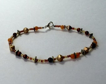 Gold and orange beaded bracelet