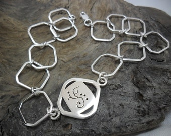 Anklet in sterling silver with carved piece