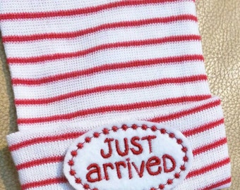 """Newborn Hospital Hat. Gender Neutral Just Arrived! Newborn Hospital Beanie. Red and White Hat with Red """"Just Arrived"""" Applique."""
