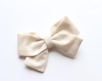 Ivory fabric bow
