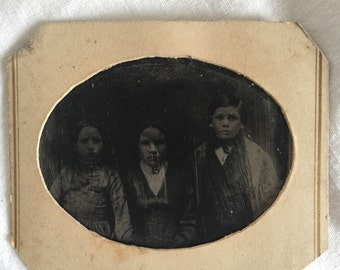 """Antique Tin Type in Paper Frame of  Three Children  2 1/2"""" by 2  """""""