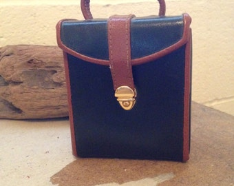 A vintage leather travel jewelry case
