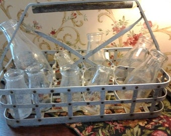 Milk bottle carrier with nine (9) milk bottles.