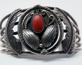 Rare vintage Native American dual-sided bracelet with turquoise and red coral stones, intricate engravings