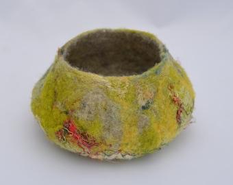 small green decorative felt vessel