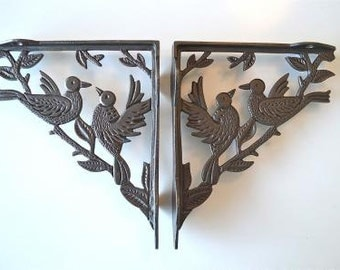 A beautiful pair of cast iron, antique style bird brackets