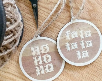 Wooden Christmas decorations. Timber typography baubles.