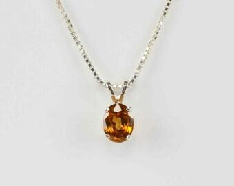 Natural Golden Orange Zircon in Sterling Silver Pendant