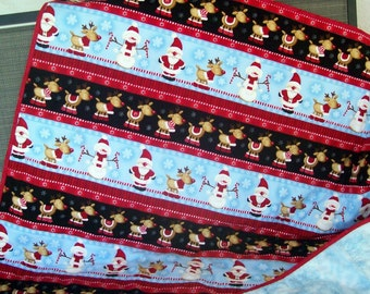 FREE SHIPPING!  Flannel Christmas Quilt.  Santa Claus,reindeer and Snowmen.  Holiday throw.