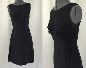 Small ** 1960s BLACK CREPE rayon bow sheath dress ** vintage sixties little black dress
