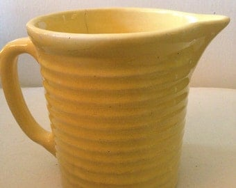 Yellow ribbed pitcher