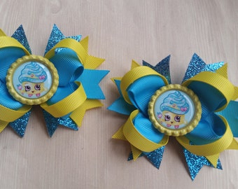 Shopkins Cupcake Queen hair bows. Set of 2. Perfect for piggy tails :) Sparkly bows!