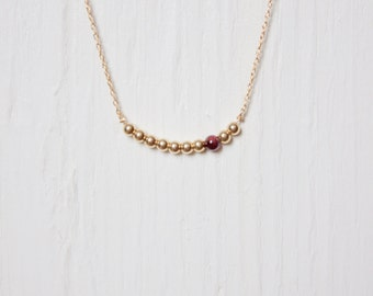 Handmade delicate gemstone necklace. Garnet and gold filled beads on a 14kt gold filled chain.