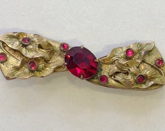 Old vintage pin brooch gold tone metal bow red glass Art nouveau