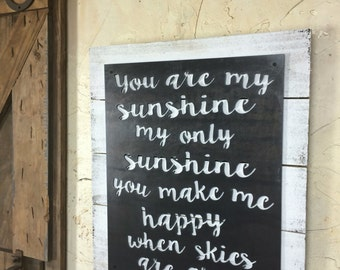 You are my sunshine! Steel and reclaimed wood wall art.