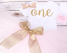"Baby Girl Gold and Pink First Birthday Glitter Cursive ""One"" Onesie Outfit With Matching Tutu, Glitter Hair Bow, and Leg warmers"