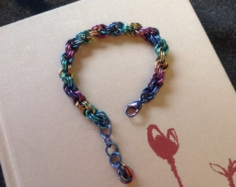 Double spiral bracelet in anodized niobium, mixed color rainbow