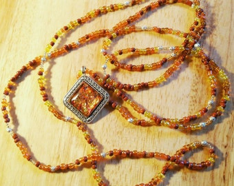 Gold and Copper Seed Bead Rope Necklace with Art Glass Pendant