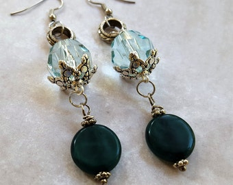 """Aqua and Teal Beaded Dangle Earrings: Faceted Aqua Bead with Silver Metal Trim, Silver Ring and Matte Teal Bead with Silver Trim. Hang 3"""""""