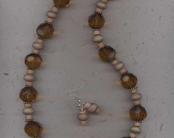 Long chunky necklace with amber - brown faceted glass and wooden beads with free matching earrings