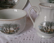 Colonial American Winter scene, Crown Bavaria china sugar basin and creamer. Match coffee pots and trios listed.